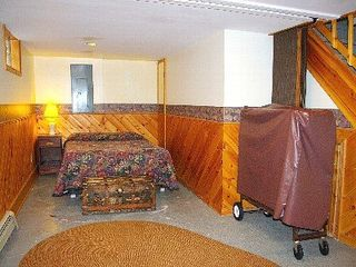 Lutsen house photo - West end of lower level. A double bed with a curtain for privacy.