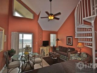 Orange Beach condo photo - Living and dining area with stairs to loft