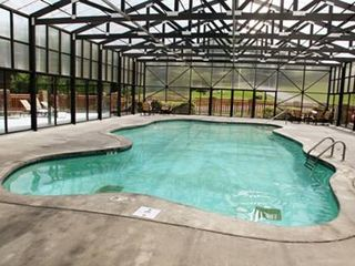 Pigeon Forge cabin photo - Indoor, heated swimming pool is just an easy stroll from Grand Getaway