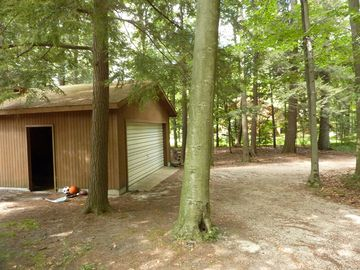 Garage and driveway leading from private road to cottage