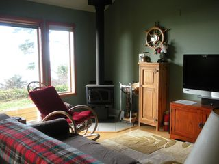 Moclips townhome photo - Comfy livingroom with woodburning stove, flat screen tv and video/dvd library.