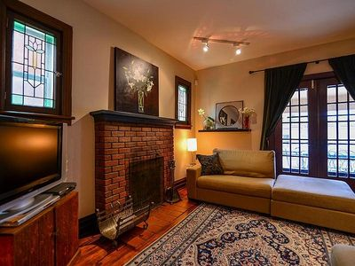 Living room with French Doors, working fireplace, flatscreen TV & full cable