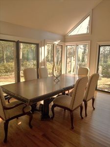 Formal dining room filled w sun and access to side gardens. Seats 8