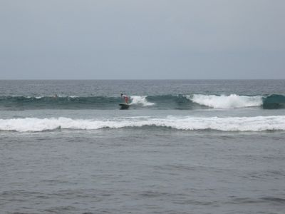 Surfing at Kahaluu board rental and lessons on the beach