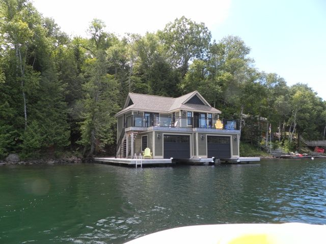 Beautiful custom built muskoka boathouse vrbo for Custom cottages for sale