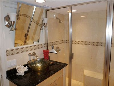 Master bath spacious shower with double headed shower, granite tops