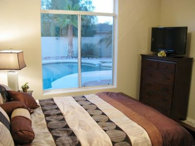 "Pool-side Bedroom - Luxurious Queen-sized  Bed - 32"" HDTV - Contemporary"