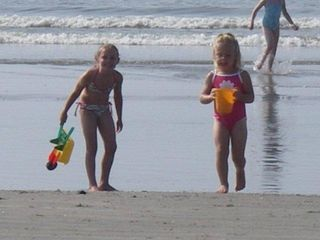 Isle of Palms condo photo - Fun on the beach - plenty of toys - beach chairs & boogie boards provided.