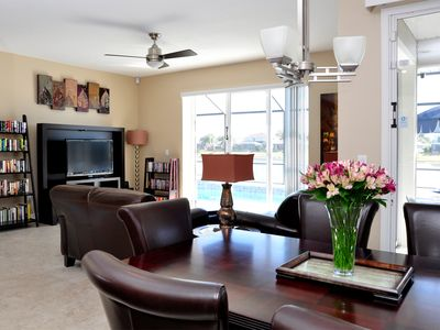 Sunset Lakes villa rental - The Living Room which overlooks the South facing pool and the Lake