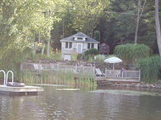 Fleetville cottage photo - view from rowboat in the lake. Private dock and floating dock
