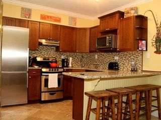 Marathon condo photo - Kitchen with granite and stainless steel appliances