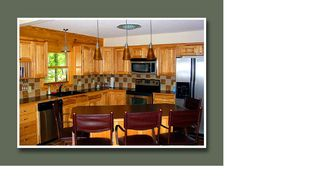Lake Gaston cabin photo - Kitchen with bar, opens to living area with cathedral ceiling & view.