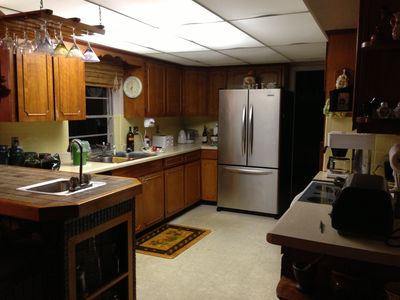 Kitchen features new appliances and built-in bar