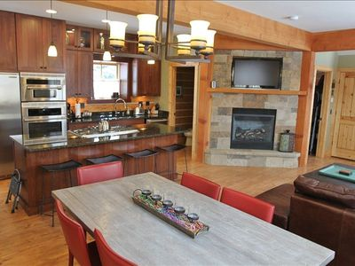 Kitchen with cherry cabinets, stainless steel appliances, and plenty of sunlight