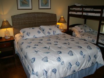Guest bedroom sleeps 4 in comfort. New mattresses on queen bed and bunkbeds.