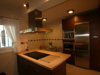 Caleta de Velez villa photo - Full kitchen. Small breakfast table. Access to east side and terrace.