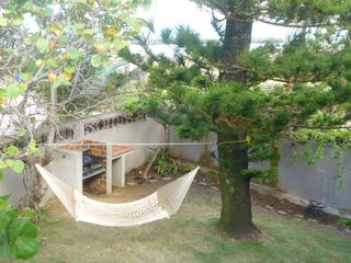 San Juan apartment photo - Relax in the shade of the pine tree while keeping an eye on the grill.