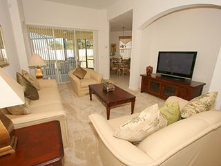Haines City house photo - Open Plan Living With Plasma TV direct access to the sparkling pool