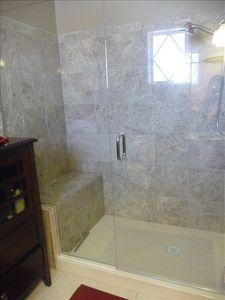 Master bath, featuring custom built shower, frameless glass shower doors, tile