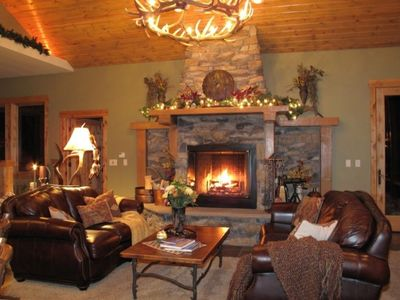 Rustic Great Room seating area with wood burning fireplace