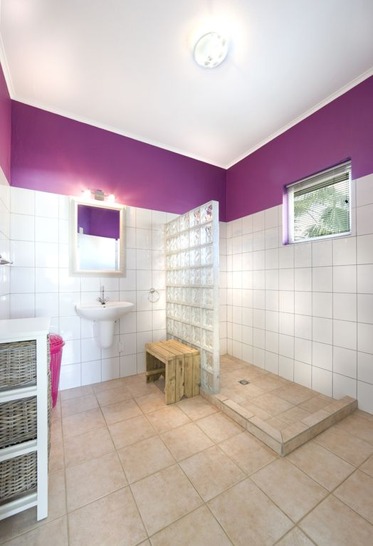 Attached bathroom to purple bedroom