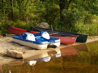 Big Bass Lake house photo - Our 2 canoes and paddleboat for use
