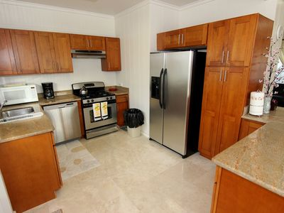 Full kitchen with new stainless steel appliances.