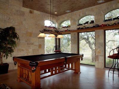 Lago Vista estate rental - Enjoy shooting pool in the open living space of this home.