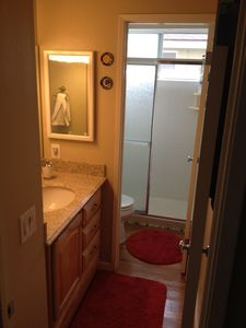 Bathroom # 2 with walk in shower. Vanity separate from shower and toilet.
