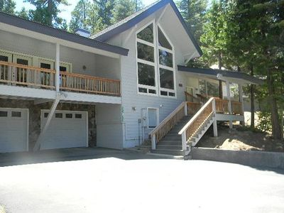 Luxurious, custom 2230 sf home on 1/3 acre surrounded by pines and redwoods.