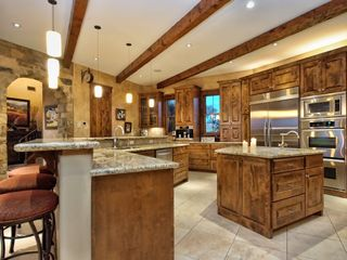 Spicewood estate photo - Kitchen fit for any Chef with Miele gourmet coffee maker, wine cooler & more!