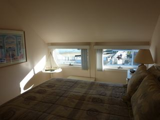 Provincetown condo photo - Bedroom with harbor views out the window