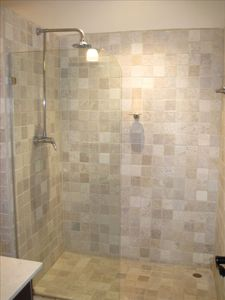 Beautifully tiled walk-in shower.
