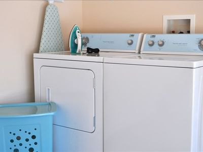 Full Sized Washer/Dryer, Iron and Board, laundry soap included for first wash.