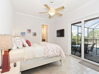 Palm Coast house photo - Bedroom 2 has queen bed, HDTV , patio access & bathroom