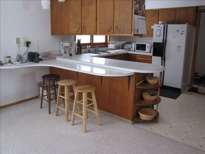 Kitchen with breakfast nook and all the amenities.