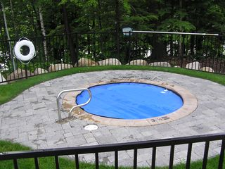 Lincoln townhome photo - Dip In The Year Round Hot Tube Then Meet @ Fire Pit On The Other Side Of Fence