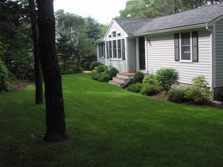 East Sandwich house photo - Lovely flowering shrubs and trees provide privacy and shade