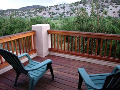 The upstairs deck features a wonderful canyon and sunset view over the river.