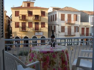 Nafplion apartment photo - Enjoying the late afternoon sun from the balcony overlooking the square.