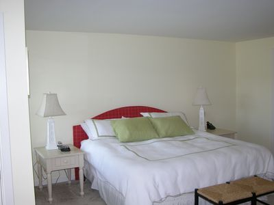 Boothbay Harbor condo rental - Master Bedroom with kind bed, double vanity bath, sitting area & Juliet balcony.