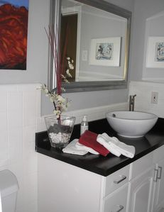 ..and get ready for the day in your updated clean and bright bathroom...