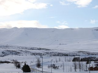 Northwest Iceland apartment photo - Winter view - Hlidarfjall ski area and golf course