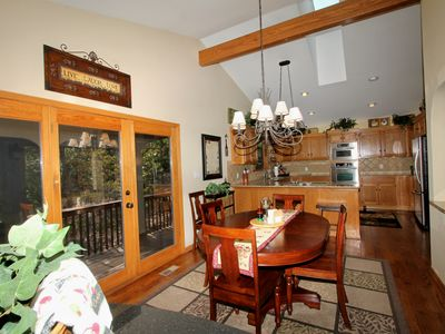 Hot Springs Village house rental - Lots of natural light in the dining area with great views of deck and trees!