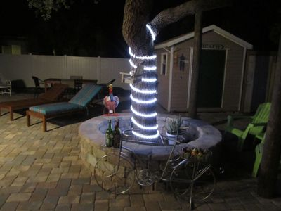 Sitting outside after dark with the romance of the tiki lights