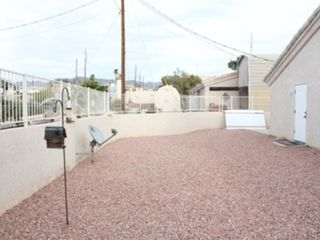 Lake Havasu City house photo - Back yard to the east with satellite dish and cactus garden behind fence