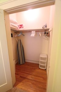 Spacious closet with iron and ironing board