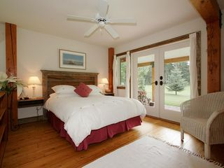 Whistler chalet photo - Bedroom with french doors out to private patio on golf course edge
