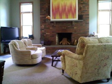 Living room with 48 in flat screen TV and premium cable/channels w/ DVD player.