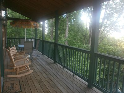 Main level deck with seating for four & a stainless steel gas grill not pictured